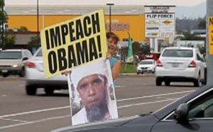 Displaying the Impeach-Obama  and Obama-bin-Laden signs.